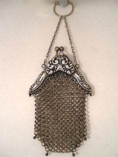 Sterling Silver Mesh Purse with a Finger Ring at the top, 1920s or earlier, 2.25 x 4 inches