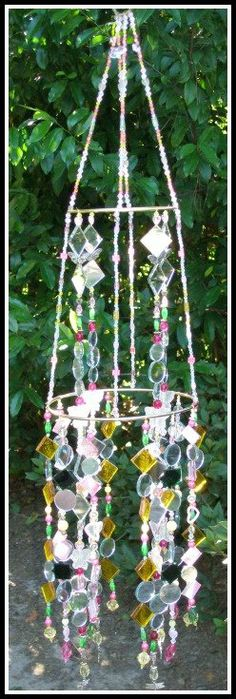 DIY suncatcher - and I know an antique store with tons of $1 costume necklaces just waiting to be repurposed!