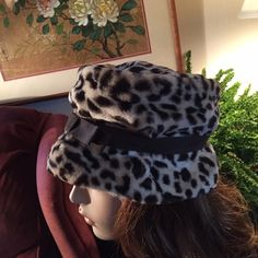 """Vintage Leopard Print Cloche Hat wBrown Ribbon Bow Classily chic leopard print faux fur cloche hat with a brown ribbon band and bow. A great hat to wear or add to your collection. Inside is fully lined in a brown sateen fabric.  Inside circumference measures approx. 21 1/2""""; height of crown approx. 3"""". 11"""" in diameter. Smoke-free home. Maker tag missing. This hat is as relevant today as it was back in the day. Mannequin for display only & not reflective of how your hat will fit.  Please…"""