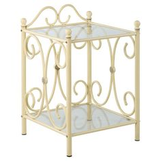 Add a charming touch to your master suite or guest room with this lovely nightstand, showcasing a scrolling wrought iron frame and soft antique cream finish....