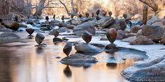 Single stone balanced on a creek. Gravity Glue by Mike Grab