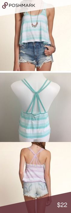 Hollister striped crop top with strappy back Hollister striped tank top in a blue / green mint color. Has a strappy back in a T-back or racer back design. The back is shown in purple for the stock photo, but the shirt is the mint green color. Size small. Tank top is slightly cropped. Very cute for summer or to wear as a beach cover-up.   🎀 No trades 🎀 No holds 🎀No modeling 🎀 Bundle to save! Hollister Tops Tank Tops