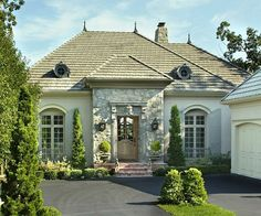 Blending limestone into stucco to make a cohesive addition to an old limestone home.  I like this look.  Providence Ltd Design - ProvidenceLtdDesign