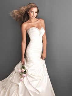 Do I like the formfitting portion, or do I just like it on her?  Hmm  Bridal Gowns