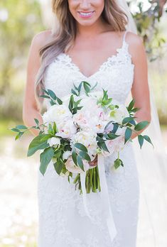 Pink Peonies, Hydrangea, Garden Roses, Heleborous, and Greenery Bouquet. For their wedding at Boone Hall Plantation in Charleston, South Carolina, (the same spot where The Notebook was filmed!) Rachel and Austin knew they wanted their day to ooze with southern charm. The bride's bouquet did just that. She carried an arrangement of peonies, hydrangea, garden roses, heleborous, and mixed greenery, created by Out of the Garden.