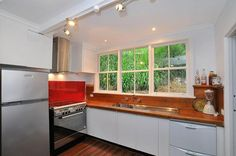 Kitchen stove and splashback close up. Kitchen Stove, Kitchen Cabinets, House On A Hill, Splashback, Home Decor, Kitchen Stove Interior, Oven, Decoration Home, Room Decor