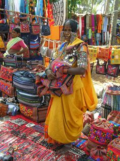 Tribal woman sells her wares at the open air Anjuna Beach Market in Goa- popular with western tourists.