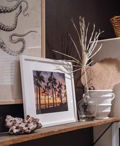 Black wall with sunset palm tree print. Palm Tree sunset print Ocean Grown. By Samba to the Sea. palm tree photography, coastal chic, coastal decor, tropical decor, tropical design, bohemian decor, boho chic, bohemian decor apartment, bohemian style, surf decor, beach shack, surf shack, surf shack design, sunset print, sunset photo print, sunset fine art print, beach print wall art, framed beach art, coastal wall art, framed beach photos, large framed beach pictures #beachprint…