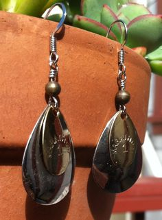 Pair of dangle earrings crafted from vintage fishing lures. A medium stainless blade is accented with a smaller, gold plated lure on top and a bronze colored bead. With three complementary colors of metal, these earrings will go well with your other jewelry and many styles of outfits.  -- $15 on Etsy