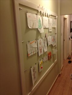 Giant frame for displaying kids artwork. Made using ikea curtain wires.