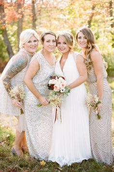 Neutral with sparkle: http://www.stylemepretty.com//2015/07/27/mix-n-match-bridesmaids-dresses-youll-love/