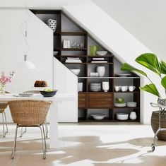 functional modern under stairs storage ideas modern dining room open shelves white dining table