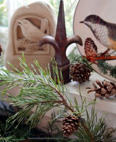 love the pinecone on branch Birds of a feather table with bird houses in Potting Shed | homeiswheretheboatis.net