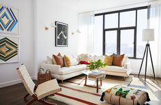 """The vibe? """"Moroccan midcentury,"""" says Sally. """"Mindy wanted it to feel different than any of the other spaces she's lived in before. She's always gone for tons of color with layers of pattern, and this time she really wanted to push herself out of that comfort zone."""" In the living room that vision materialized with a sectional by Kim Salmela (upholstered in stain-resistant Crypton) balanced by a patterned pouf from Habibi Imports. A vintage kilim anchors the space, pulling in the tones of…"""