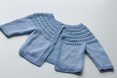 Eyelet yoke baby cardigan. Lion Brand Yarns pattern