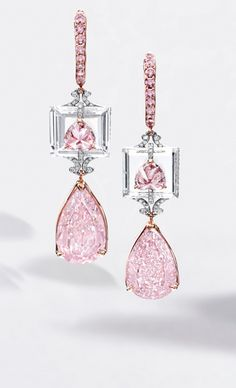 Rare and Exquisite Pair of Fancy Intense Purple-Pink Diamond, Fancy Intense Purplish-Pink Diamond and Diamond Pendent Earrings:  Suspending a pear-shaped fancy intense purple-pink diamond weighing 4.01 carats and a fancy intense purplish-pink diamond weighing 3.72 carats, surmounted by fancy purplish pink and fancy intense pink diamond weighing 0.63 and 0.55 carat respectively, to a step-cut diamond background altogether weighing 5.05 carats, mounted in white and pink gold