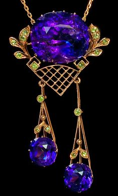 The Royal Romanov Family of Russia and Tsar Nicholas II Memorabilia. An Impressive Antique Russian Siberian Amethyst and Demantoid Garnet Rose Gold Pendant Necklace  made in Moscow between 1908 and 1917 Three deep velvet purple Siberian amethysts, sixteen Ural demantoids, 56 zolotniks rose and yellow gold (14K-583) The biggest amethyst is approximately 35 ct. ( 20.7 x 17.9 mm)  Height 2 1/2 in. (6,4 cm)