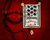 """Sayyedat elArdh FALASTEEN necklace (unisex) ,wood,glass,metal beads,handmade embroidery,vintage,pendant, Palestinian scarf kufiyyah, canva, DMC knits سيدة الأرض فلسطين للشباب والصبايا Handmade, embroidered & designed by Rim Banna   Some of the beads might change ..  It is possible to change the calligraphy words on the item  Like """"KNITS & COLORS"""" facebook page ..  And follow us on Etsy"""
