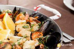 Yummm! We are hungry for paella!  Where did you enjoy the tastiest seafood in #Barcelona? #GowithOh