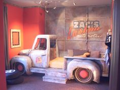 Keep on Truckin boys bedroom with a hand built truck as a bed.  I don't know who would want this more, Dad or son.  Even the wall was painted to look like a garage.  Would your son go crazy for this?