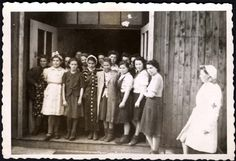 Dachau, Germany, Women survivors after being bathed (first time since their internment, given clothes and food and rescuers, after the liberation. What they witnessed and what they did to survive is written on their faces and burned forever in their eyes and memories