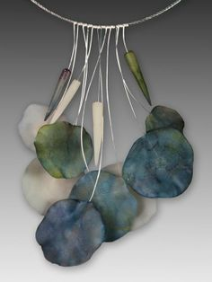 Beautiful necklace with transparent clay and inks ( from what I can tell)