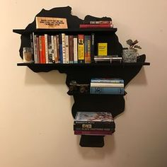 Jazz up your home or office with this unique book shelf. Large Africa shelf Handmade out of tall/ wide 5 shelves deep. Attached with a French cleat to the wall. (Instructions will be included,it's not Hard to Bookshelf Design, Bookshelves, African Room, African Living Rooms, African Theme, Living Room Designs, Living Room Decor, Living Area, Deco Cafe