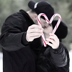 Love this idea for Christmas picture of couples together. With candy cane make look like a heart in this picture.
