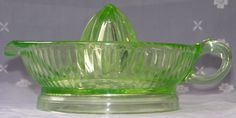 Side view of large Anchor Hocking Glass Co. green glass juicer