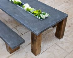 love! outdoor dining table - concrete top, reclaimed beams or railroad tie legs - center for flowers or filled with ice for drinks...