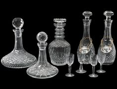 GROUP OF FIVE WATERFORD DECANTERS - Estimate: $150 - $200