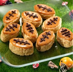 thinking peanut butter instead of caramel........ Kellogg's® Rice Krispies Treats® bars dipped in caramel and decorated with chocolate in honor of the Big Game.