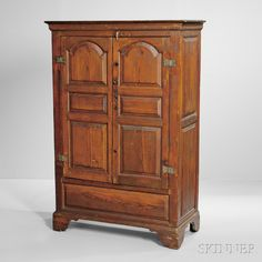 Yellow Pine Clothes Press, Eastern Shore, Virginia, c. 1770, the flat molded cornice above two doors with tombstone raised panels and rectangular panels below, the sides with double panels, all on bracket feet, (restoration to base), ht. 66, wd. 41 1/4, dp. 19 in.