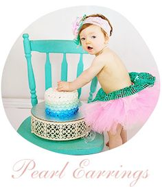 photo prop pearl earrings for her 1st birthday smash cake session - adorable in her mermaid tutu and pearls!