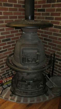 The Union Stove Works Antique Cast Iron Potbelly Stove No.
