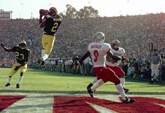 Charles Woodson Micigan Wolverines | Michigan cornerback Charles Woodson (2) leaps to make an interception ...
