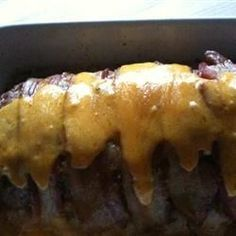 Meat loaf that is covered in bacon and oozing with Cheddar cheese is sure to be a crowd pleaser!
