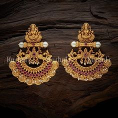 Designer antique earrings studded with ruby stones and beads plated with gold polish and made of copper alloy! Antique Earring 124641 Designer antique earrings studded with ruby stones and beads plated with gold polish and made of copper alloy! Indian Jewelry Earrings, Jewelry Design Earrings, Gold Earrings Designs, Gold Bangles Design, Antique Earrings, Gold Designs, Ruby Earrings, Feather Earrings, Pendant Jewelry