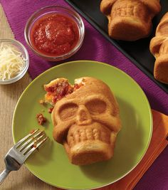 Stuffed Pizza Skull from @joannstores.  Use the Dimensions® 3-D Mini Skull Pan to make an ooey gooey stuffed pizza skull that will give guests a yummy fright when they bite into it!