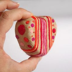 Felted Soap with Stripes and Dots (Scent: Cranberry Fig). $18 - £11.80  High quality soaps & exfoliating power of soft Merino wool.  Hold bar under running tap, rub gently & suds lather through the wool.  Use grid-like soapdish to drain & dry.  Lasts longer than regular soap and every bit is used up.  Leaves you with reusable wool product e.g. scrubbing pad; pouch (put slit in one end); drawer freshener (just insert few drops of essential oils; or place your favorite soap inside and use it…