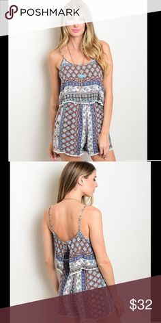 """Tribal Print Romper With a flounce layer on the bodice and a fun tribal print fabric this romper is the definition of beautiful. Other features include spaghetti straps and a round neckline. L:31"""" B:34"""" W:36"""" Other"""