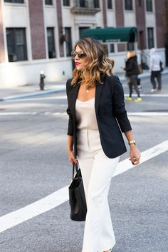 A classic office look: white wide-legged trousers, an off-white camisole, a black blazer and a pop of red lip #ootd #fashion #style