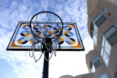 Literally Balling by Victor Solomon makes hoop backboards fit for cathedral parking lots