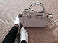 Converse sneakers and michael kors bag