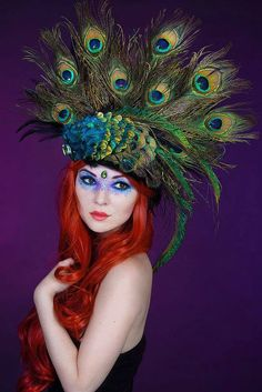 Love everything about this~from her hair color to the peacock feathers! Headdress by Firefly Path, photography by Leena on model San Da.