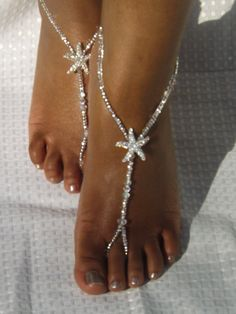 This pair of barefoot sandals was made with Swarovski elements, silver lined glass beads, Rhinestone starfish, and AB crystals.  If you have any questions, please feel free to contact me.  THESE ARE AN ORIGINAL DESIGN OF SUBTLE EXPRESSIONS; BE RESPECTFUL, DO NOT COPY.