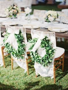Lush green garlands look lovely atop lace chair covers. Wedding Decorations, Wedding Chairs, Bride and Groom Chairs Wedding Chair Decorations, Wedding Chairs, Decoration Table, Wedding Tables, Greenery Wreath, Wreaths, Flower Studio, Sweetheart Table, Nautical Wedding