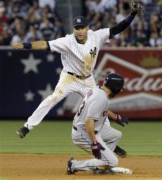 GAME 73: Tuesday, June 26, 2012 - New York Yankees shortstop Derek Jeter, left, leaps to avoid Cleveland Indians' Johnny Damon after forcing out Damon when the Indians' Casey Kotchman hit into a fifth-inning double play during the Yankees' 6-4 win in their baseball game at Yankee Stadium in New York.