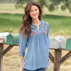"""Embroidered across the pintucked yoke, front and back, are a profusion of pastel blooms, with more at the hem for good measure. Hand pickstitched neckline and placket, three-quarter sleeves. Rayon. Machine wash. Imported. Exclusive. Sizes XS (2), S (4 to 6), M (8 to 10), L (12 to 14), XL (16). Approx. 28-1/4""""L."""
