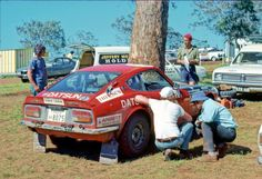 Edgar Hermanns' factory Datsun 240Z, the Japanese factory a big supporter of Australian Rallying for a decade or so. Navigator Roger Bonhomme. Here the car is being serviced at the Mt Ginn stage outside Canberra.